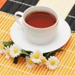 Royalty-Free Stock Photo: Cup of tea and camomiles