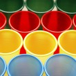 Plastic cups of various colours — 图库照片