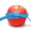 Red apple and measuring tape — Stock Photo