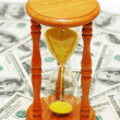 Time is money with dollars — Stock Photo