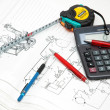 Royalty-Free Stock Photo: Design drawings, calculator, pens