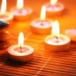 Candles and pebbles for spa session - — Stock Photo
