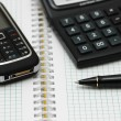 Mobile phone, calculator and pen — Stock Photo