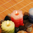 Three candles and stones for spa — Stock Photo #2659009