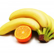 Bunch of bananas and orange isolated — Stock Photo #2659144