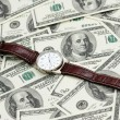 Hand watch over the hundred dollars — Stock Photo #2659810