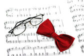 Bow tie and reading glasses — Stock Photo