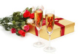 Giftboxes and champagne isolated — Stock Photo