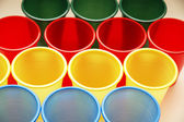 Plastic cups of various colours — Stock Photo