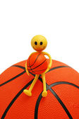 Smilie sitting on basketball isolated — Stock Photo