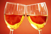 Two wine glasses on the biege — Stock Photo