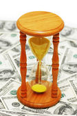 """""""Time is money"""" with dollars — Stock Photo"""