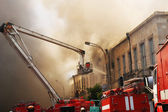 Firefighters at the fire in the city — Stock Photo