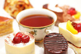 Selection of sweet cakes and tea — Stock Photo