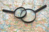 Agnifying glasses over the map of London — Stock Photo
