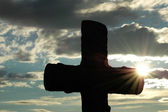 Silhouette of a cross against sun — Stock Photo