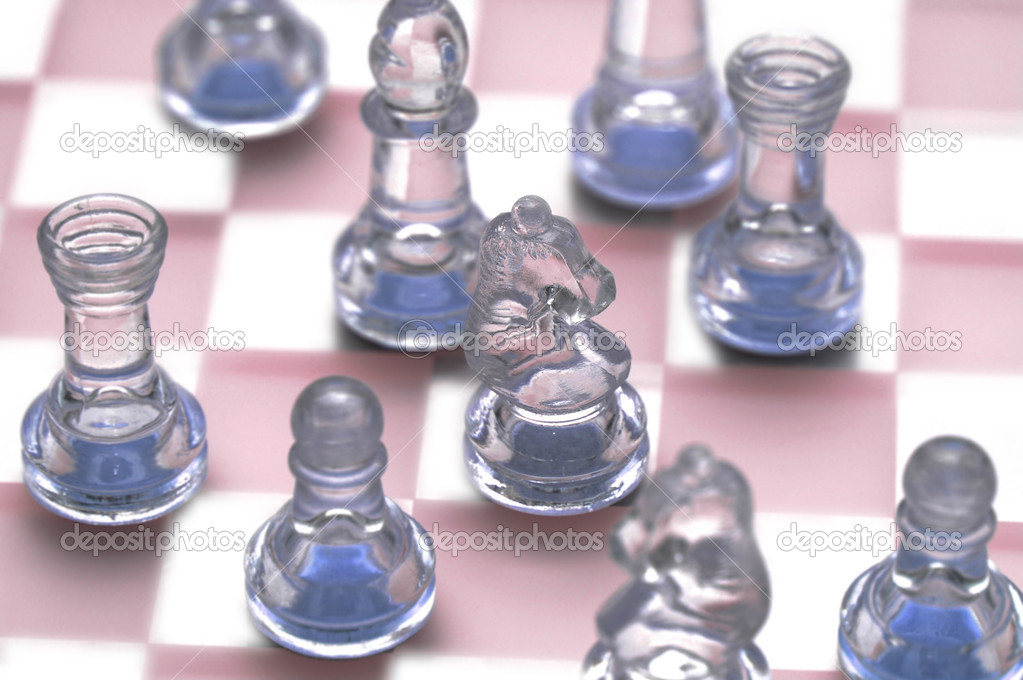 Various chess figures on  the glass chessboard — Stock Photo #2653836