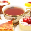 Stock Photo: Sweet cake with berries and cup of tea