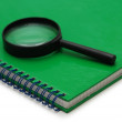Magnifying glass over the notebook — Stock Photo
