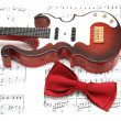 Guitar and bow tie over the sheet — Stock Photo