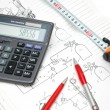 Design drawings, calculator, pens — Stock Photo #2660724