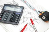 Design drawings, calculator, pens — Stock Photo