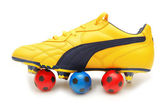 Yellow soccer footwear and footballs — Stock Photo