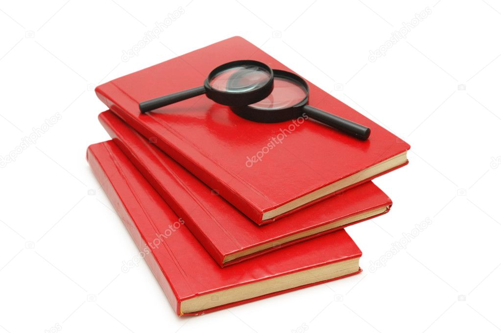 Three books and magnifying glasses isolated on white — Stock Photo #2660572