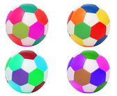 Footballs of four different colors — Stock Photo