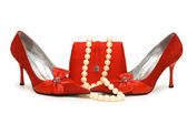 Red shoes, purse and pearl necklace — Stock Photo