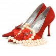 Red shoes and pearl necklace isolated — Stock Photo #2680097