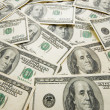 Stock Photo: Lots of dollar bank notes scattered