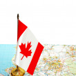 Canada flag on the map against white — Stock Photo