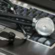 Stethoscope and laptop — Stock Photo