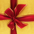 Close up of the gift box with red ribbon - Foto Stock