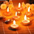 Candles, flowers and pebbles — Stock Photo