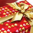 Close up of gift box with ribbon - Stock Photo
