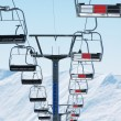 Stock Photo: Ski lift chairs on bright winter day