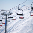 Stock Photo: Ski lift chairs on bright day