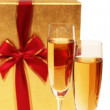 Giftbox and champagne isolated - Stock Photo