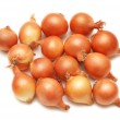 Lots of onions isolated on white — Stock Photo