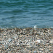 Water and small pebbles at the beach — Stock Photo #2687140