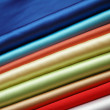 Royalty-Free Stock Photo: Stack of satin fabric of various colours