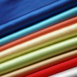 Stock Photo: Stack of satin fabric of various colours
