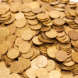 Pile of golden coins isolated — 图库照片