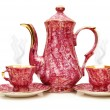 Tea pot and cups isolated on  the white - Stock Photo