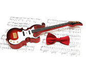 Musical notes, guitar and bow tie — Stock Photo