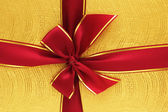 Close up of the gift box with red ribbon — Stock Photo