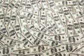 Beaucoup de billets de banque du dollar sur la table — Photo