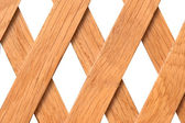 Wooden trellis with rhomb holes — Stock Photo